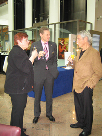 Enjoying A Light Moment And Toasting To The Success Of The Exhibition, 2008